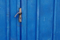 Blue door and handle Royalty Free Stock Images