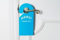Blue door hanger on white door Stock Images