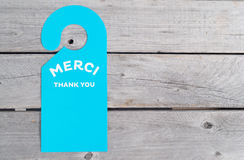 Blue door hanger on wooden table Royalty Free Stock Photography