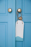 Blue door with hanging sign. Blue color retro style wooden door with hanging sign board Royalty Free Stock Photography