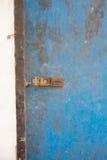 Blue door with iron door locked Stock Photo