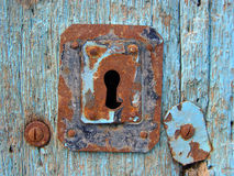 Blue door with keyhole. Blue door with rusty keyhole royalty free stock photo