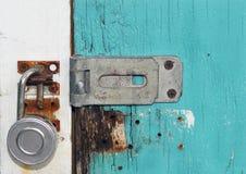 Blue Door Lock. Lock in blue deteriorated door stock image