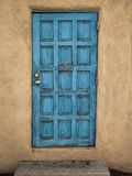 Blue Door, Mud Wall Stock Photo