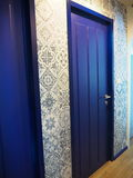 Blue door. And nice wallpaper Royalty Free Stock Photography