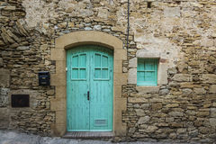 Blue door in an old building made of stone Royalty Free Stock Images