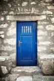 Blue door in old stone house. Croatia Stock Photography