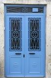 Blue Door. Blue old Door on Stone Wall Royalty Free Stock Image