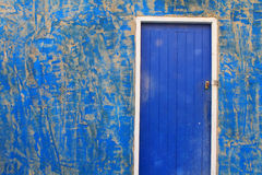 Blue door and old wall Stock Images