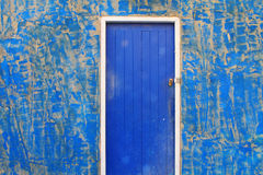 Blue door and old wall Royalty Free Stock Images