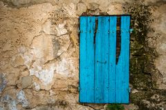 Blue door in old wall Royalty Free Stock Image