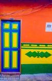 blue door of orange house stock image