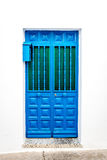 Blue door over white wall Royalty Free Stock Photos
