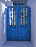 Blue door peeling paint Royalty Free Stock Images