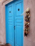 Blue Door and Peppers Stock Photos