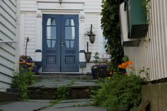 Blue Door. Plants surround a Blue Door at one of the white painted houses in Old Stavanger, Norway Stock Photography