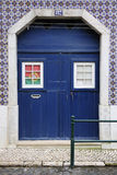Blue door with portuguese flag Stock Photo