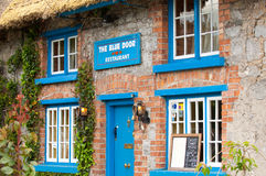 Blue door restaurant Stock Photography
