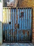 Blue door with rusty metal stock image