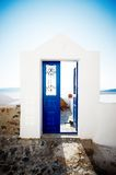 Blue door on Santorini. A beautiful blue door in a whitewashed building typical to the Greek island of Santorini Stock Images
