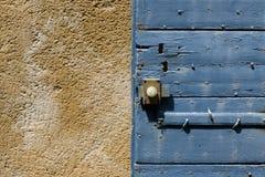 Blue door shutter Stock Images