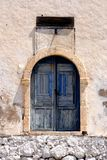 Blue door with solar clock Royalty Free Stock Image