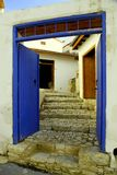 Blue door and stone steps in the old village of Laneia, Limassol district, Cyprus royalty free stock photos