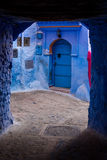 Blue door on a street of Chefchaouen, Morocco Stock Photo