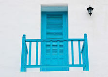 Blue door and terrace Stock Image