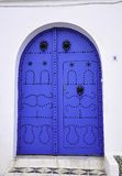 Blue door. Tunisia's ancient and beautiful garden Gates Stock Image