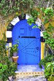 Blue door. Tunisia's ancient and beautiful garden Gates Royalty Free Stock Image
