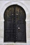 Blue door. Tunisia's ancient and beautiful garden Gates Stock Photo