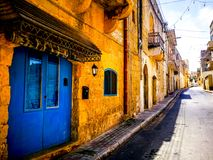 Blue door typical street in Gozo, Malta royalty free stock image