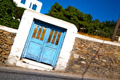 Blue door in  village  greece europe and    white wall Royalty Free Stock Photography