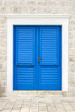 Blue door. On a white stone building Stock Photography