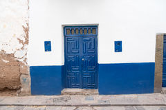 Blue door and white wall Royalty Free Stock Photo
