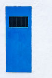 Blue door and white wall Stock Photo