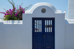 Blue door and white wall Stock Images