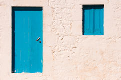 Blue door and window Royalty Free Stock Image
