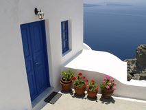 Blue door and window on Santorini island Royalty Free Stock Photos