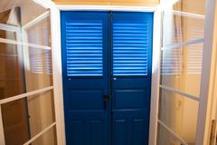 Blue door and window  with shutters Royalty Free Stock Image