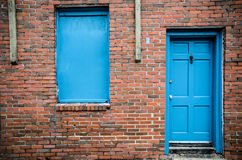 Blue door and windows, brick building, Treme, New Orleans Stock Image