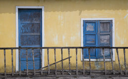 Blue door and windows with wooden balcony Royalty Free Stock Photo