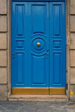 Blue door with yellow door knob Royalty Free Stock Photos