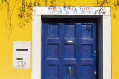 Blue door and yellow wall Royalty Free Stock Photography