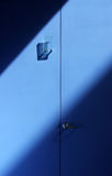 Blue Doors. Sunsplashed doors to public restroom Stock Photos