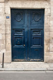 Blue doors in Paris. Old style painted  in blue doors in Paris Stock Photos