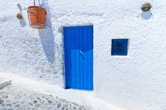 Blue doors of Santorini. Architecture of Oia village at Santorini island, Greece Stock Image