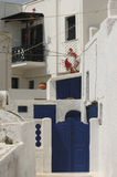 Blue doors of Santorini. Blue gates and white walls in Santorini Stock Photo