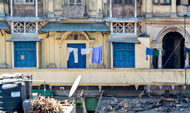 Blue doors and shutters of typical houses with roof life in old Delhi, India Stock Images